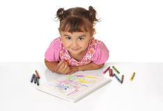 Girl coloring with crayons Royalty Free Stock Images