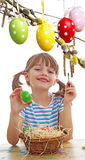 Girl coloring easter eggs Royalty Free Stock Photo