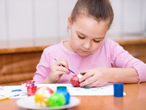 Girl are coloring eggs Stock Images