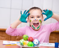Girl are coloring eggs Royalty Free Stock Image