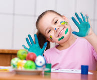 Girl are coloring eggs Stock Photo