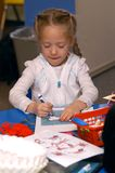 Girl Coloring At School royalty free stock photography