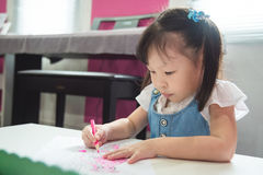 Girl coloring with wooden pencils at the school Royalty Free Stock Photography