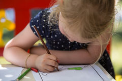 Girl coloring Royalty Free Stock Image