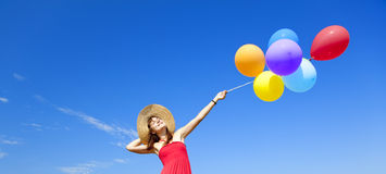 Girl with colour balloons Stock Photos