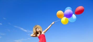 Girl with colour balloons Stock Photos