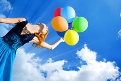 Girl with colour balloons Stock Images