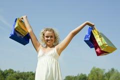 Girl with Coloured Shopping bags Stock Photos