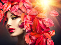 Girl with colourful autumn leaves hairstyle. Autumn Woman. Fall. Girl with colourful autumn leaves hairstyle Stock Photography