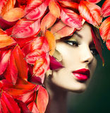 Girl with colourful autumn leaves hairstyle Royalty Free Stock Photography