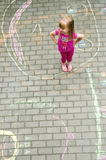 Girl in colourful backyard Royalty Free Stock Image