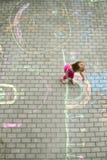 Girl in colourful backyard Stock Photography