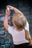 Girl in colourful backyard Royalty Free Stock Photos