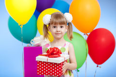 Girl with colourful balloons and gift Stock Photos