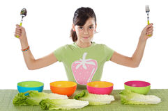 Girl with colourful bowls Stock Images