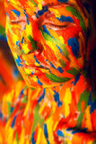 Girl in colourful paint strokes Royalty Free Stock Photography