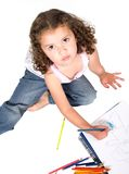 Girl colouring a drawing Stock Photography
