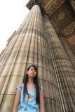 Girl and Column Stock Photos