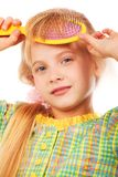 Girl with comb Royalty Free Stock Photo