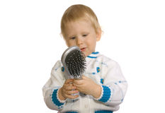 Girl and comb Royalty Free Stock Image
