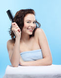 Girl with comb Stock Images