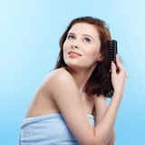 Girl with comb Stock Photography