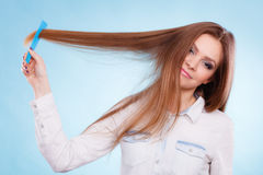 Girl with comb. Stock Images