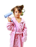 Girl with a comb in hair curlers royalty free stock photo