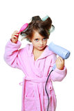 Girl with a comb in hair curlers Royalty Free Stock Photos
