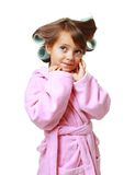 Girl with a comb in hair curlers Stock Photos