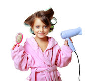 Girl with a comb in hair curlers Stock Images
