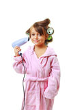 Girl with a comb in hair curlers Stock Image
