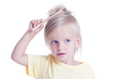 Girl with comb Stock Photo