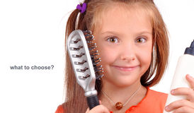 Girl with a comb on a white background Royalty Free Stock Images