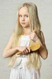 Girl combing hair Royalty Free Stock Photo