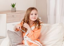 GIrl is combing hair royalty free stock photos