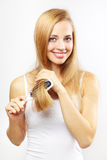 Girl combing of her hair. light background Stock Photo