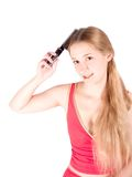 Girl combing her long hair Royalty Free Stock Images