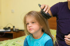 Girl combing her long hair massage comb Stock Images