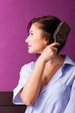 Girl combing Stock Photos