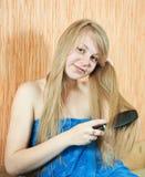 Girl combing  long hair Royalty Free Stock Photos