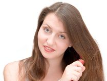 Girl combs hair Royalty Free Stock Photos