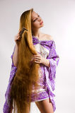 The girl combs long hair Stock Image