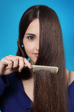 Girl combs long hair Stock Images