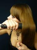 Girl combs to itself hair. Young beautiful girl combs to itself hair royalty free stock images