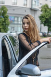 Girl comes out of the car Stock Image