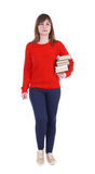 Girl comes with stack of books. front view. stock photo