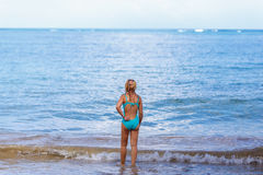 The girl comes to the sea Royalty Free Stock Images