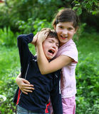 Girl  comforting and hugging crying brother boy Royalty Free Stock Photography
