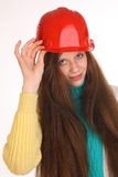 Girl comic builder in the building helmet. Royalty Free Stock Photography